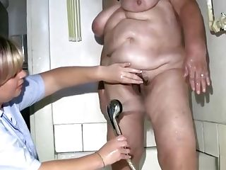 Granny Showered By Girl/girl Nurse