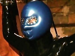Lady In Spandex With Inflatable Fetish Mask Spanked